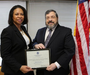 Ms. Kimberly Walton, TSA's assistant administrator for civil rights and liberties, ombudsman and traveler engagement, presenting Rabbi Abba Cohen, Agudath Israel's vice president for federal affairs and Washington director, with a certificate of appreciation