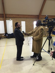 Rabbi Ariel Sadwin speaking to a reporter from WBAL