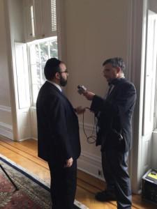 Rabbi Sadwin being interviewed by WBAL news anchor Robert Lang