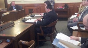 Rabbi Schnall testifying before the Assembly committee.