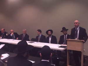 Chicago community rabbis listening to Gary Schenkel, executive director, Office of Emergency Management and Communications, City of Chicago.