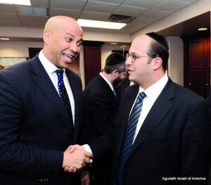 Senator Cory Booker with Rabbi Avi Schnall.