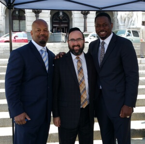 On the steps of the PA State Capitol, Rabbi Sadwin poses with former NFL star and product of nonpublic schools, Rickey Watters (on right), and with Otto Banks, the executive director of the Reach Foundation, PA's school choice coalition.