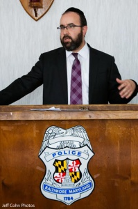 Rabbi Ariel Sadwin speaking to Baltimore police officers at the NW precinct