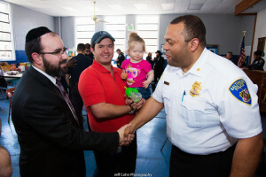 Rabbi Sadwin greeting Major Marc Partee, who is responsible for police operations for the northwest district