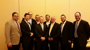 Assemblyman Gary Schaer (D - Passaic) and Rabbi Avi Schall, Agudath Israel's New Jersey director (third and second from right), with some of the local attendees at an Agudath Israel event in Elizabeth, New Jersey
