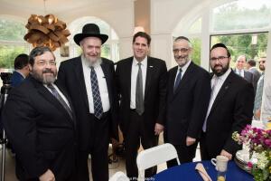 Rabbi Abba Cohen, Rabbi Sheftel Neuberger (president of Ner Israel Rabbinical College), Israeli Ambassador Ron Dermer, Rabbi Chaim Dovid Zwiebel, and Rabbi Ariel Sadwin