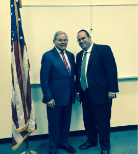 Rabbi Avi Schnall thanking Senator Menendez at Seton Hall after his announcement.