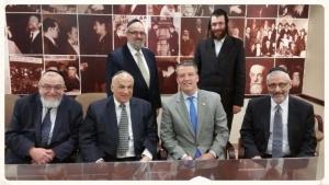 Pictured: Rabbi Shmuel Lefkowitz, vice president for community services, Dr. Yasher Hirshaut, Mordechai Avigdor, Esq., Senator Murphy, Yossi Menczer, Rabbi Chaim Dovid Zwiebel, executive vice president Agudath Israel of America