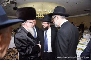 Israeli Minister of Health MK Rabbi Yaakov Litzman speaking with  Rabbi Moshe Matz, director of Agudath Israel of Florida and Rabbi Chaim Dovid Zwiebel, Agudath Israel of America's executive vice-president, at Agudath Israel of Florida Shabbos of Chizuk last week. Also pictured is Agudath Israel of America board of trustee member Mr. Chaskel Bennett.