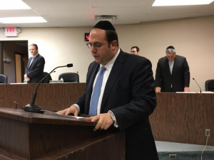 Rabbi Schnall delivering the invocation at the swearing-in ceremony of the Lakewood Township government where Agudath Israel of America's 2015 William K. Friedman Leadership awardee Menashe Miller was sworn in as mayor.