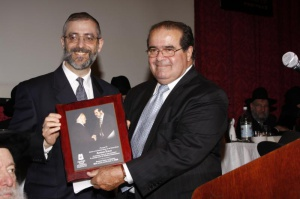 Rabbi Chaim Dovid Zwiebel, Agudath Israel's executive vice president, presenting Justice Scalia with a photo of the late Rabbi Moshe Sherer and the Justice