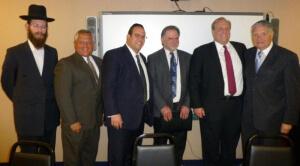 Rabbi Balsam; Gus Kavakas; Rabbi Avi Schnall, Agudath Israel's NJ director; State Monitor Mike Azzara; Commissioner David Hespe; Senator Robert Singer (R-Monmouth)